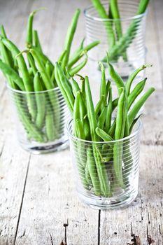 green string beans in glasses