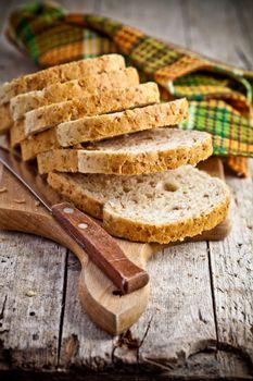 fresh bread slices on wooden board