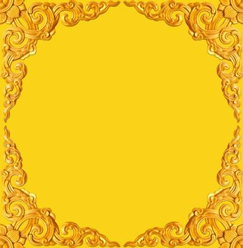 golden flower carve frame isolated on yellow background