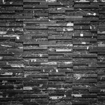 old black brick wall pattern as background
