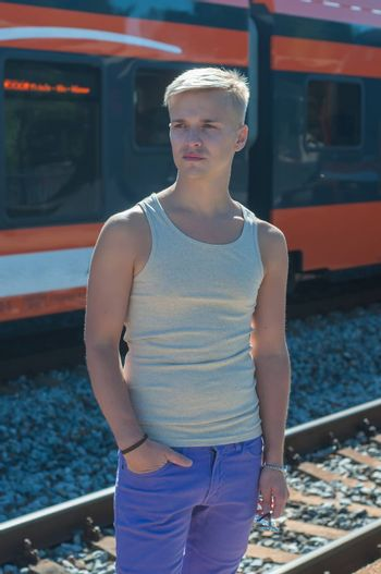 Young man on the background of the train