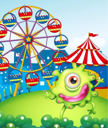 A one-eyed green monster at the carnival in the hilltop