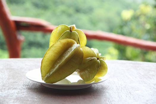 Fresh star fruit in dish on the foods table.