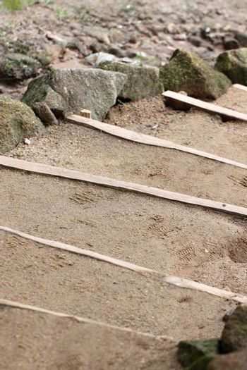 Stairs were made of sandy soil in the garden.