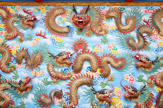 Dragon sculpture on wall in Chinese temple,Thailand.