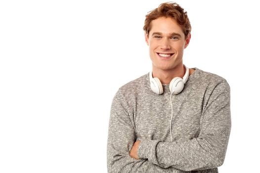 Handsome smiling man with folded arms