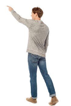 Caucasian man standing pointing