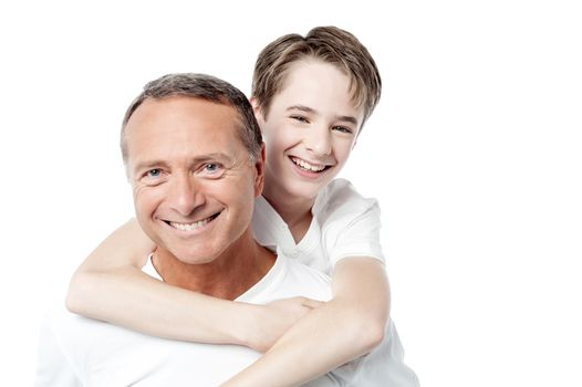Smiling father holding son on his shoulders