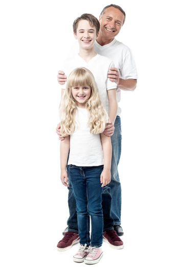 Smiling father with children standing in a row