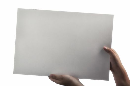 White Plastic laminate sign held up by hands