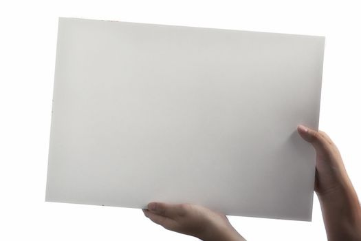 A light white plastic laminate square blank sign supported by young hands on light background