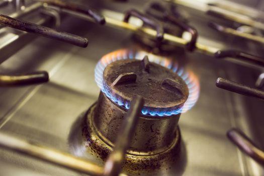 Burning gas on kitchen gas stove
