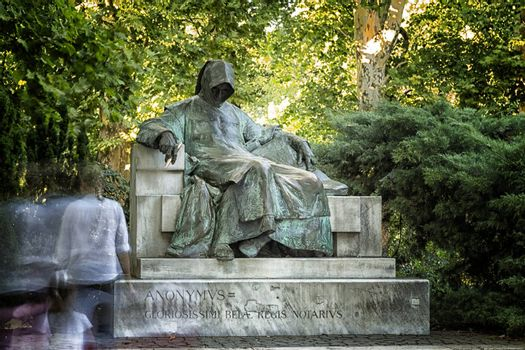 the Statue of Anonymous is in front of the Vajdahunyad Castle in the City Park, Budapest.