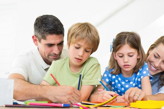 Parents assisting children in coloring
