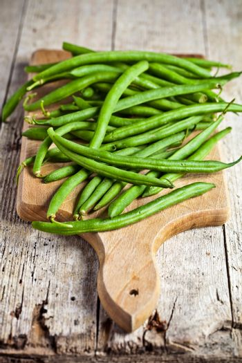 green string beans on wooden board