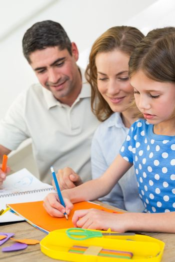 Parents looking at girl coloring
