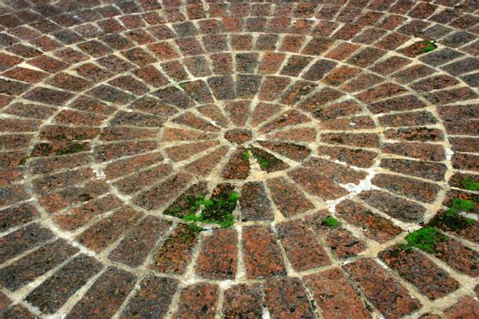 pavement of cobble stones in a circle pattern