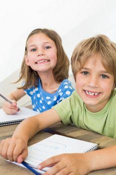 Siblings coloring at table