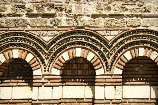 Old Stone Exterior Decoration With Arc and Different Elements