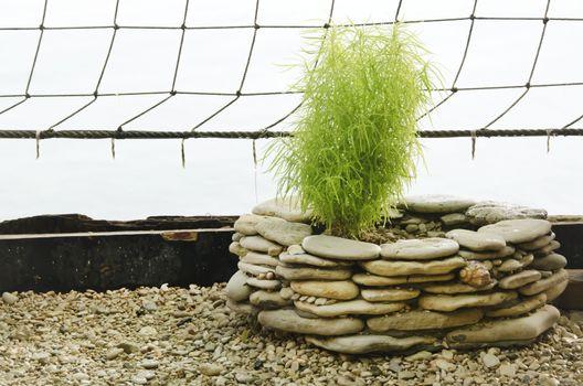 Gardening Decoration: Stone Pot, Pebbles and Net