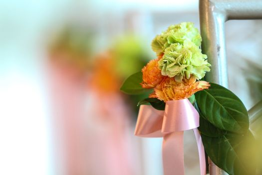 Closeup bouquet carnation flowers and pink ribbon