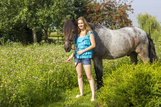 young girl and her horse