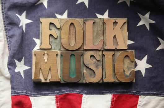 an American flag with the words folk music in old wood type