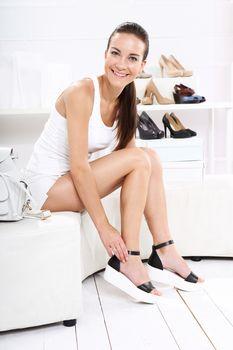 Women buy shoes