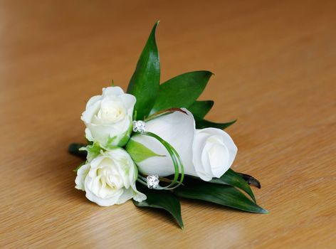 Mothers corsage is white rose on wedding day
