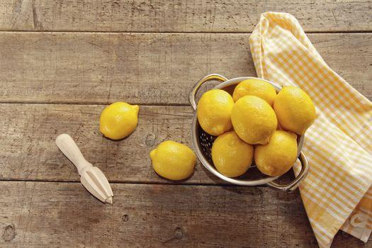 Fresh lemons on wooden counter