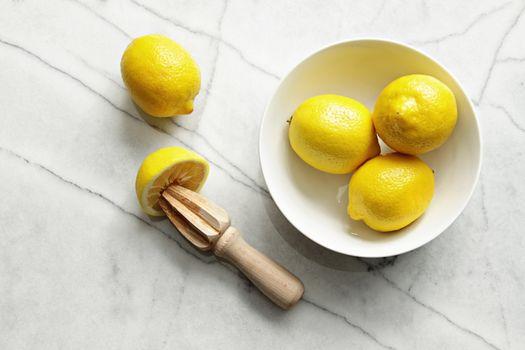 Fresh lemons on marble counter
