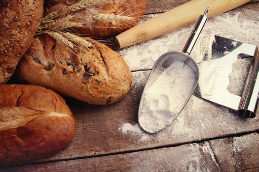 Homemade breads with cooking utensils