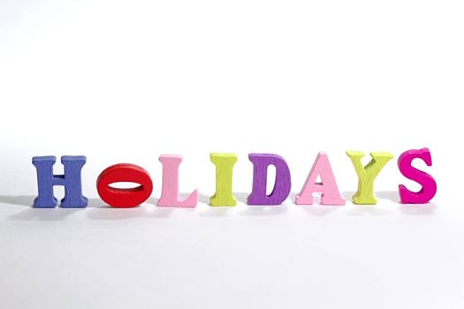 Photo shows detail of holidays sign on white background.