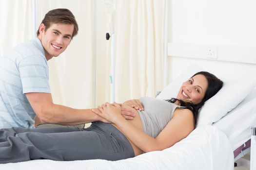 Happy expectant couple in hospital