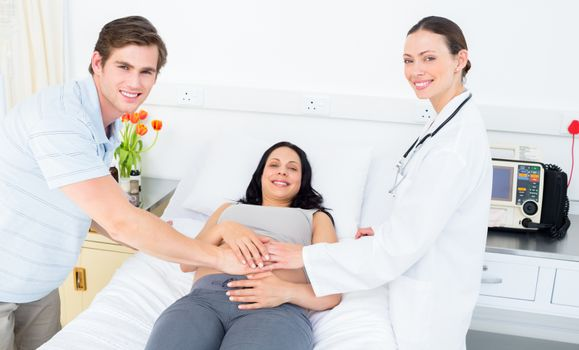 Happy doctor and expectant couple
