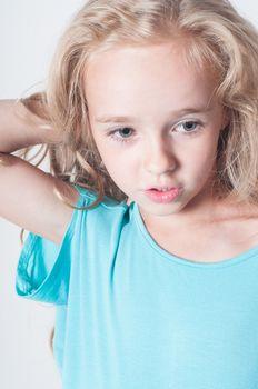 Adorable portrait of little girl in blue
