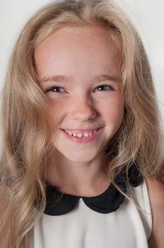 Adorable portrait of little girl in white