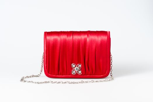 Woman little red purse on white background