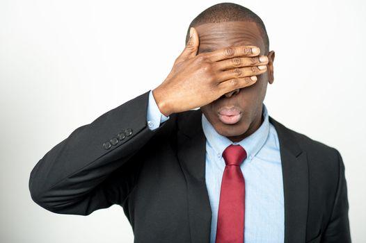 Business executive hiding his eyes