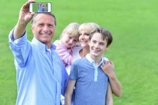 Family capturing their enjoyment