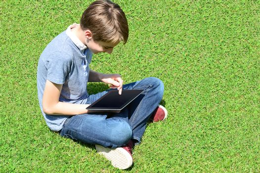 Young boy gaming on his new tablet pc