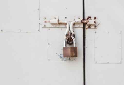 Master key is lock on white steel door