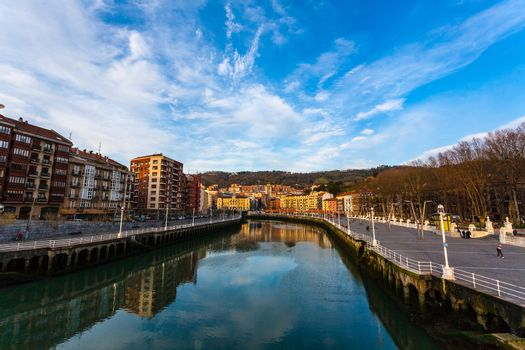 Pan view of Nervion river in the city center of Bilbao with promenade on the right Basque Country Spain