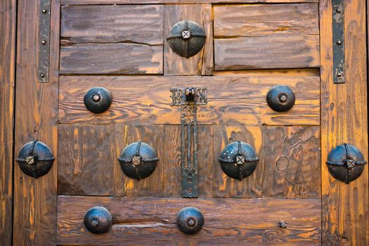 Detailed view of ancient door with beautiful iron fitting decoration