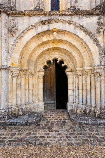 View of main entrance door with archivolts and columns in Petit Palais et Cornemp romanesque chruch in  in the Gironde department of France
