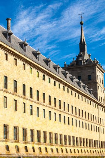 Perspective view of the Royal Site of San Lorenzo de El Escorial wir its dormer windows on the roof and a tower at the bottom