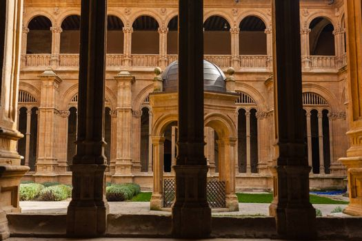 View of San Esteban dominican convent cloister with renaissance columns in the forefront in Salamanca Spain