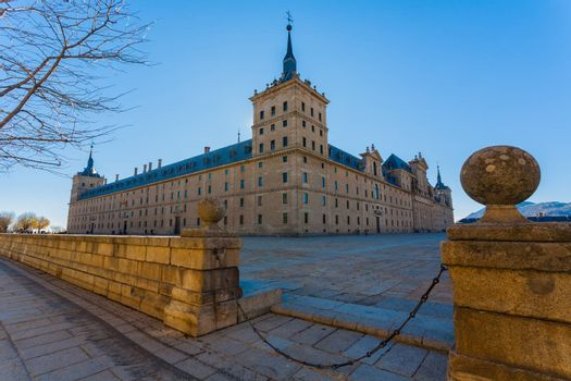 Full view of San Lorenzo de El Escorial Royal Site  showing the surounding big square and   its enormous architectural structure , Madrid Spain