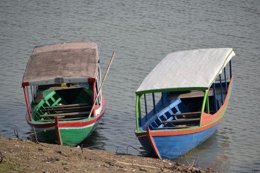padalarang, indonesia-august 1, 2014: boat that people used for fishing at saguling lake padalarang, west java-indonesia.