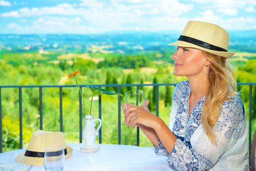 Traveler girl in outdoors cafe